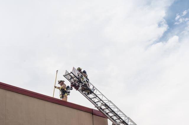 Firefighters on roof top