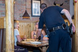 police officer serving patrons at a restaurant